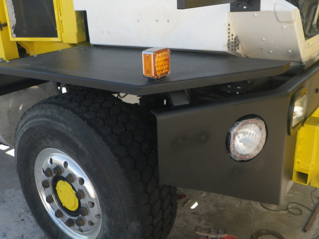 front fenders modified to line up with bumper, fabricated braces, painted